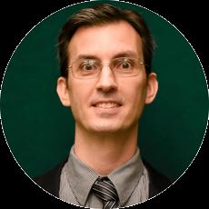 Circular headshot of Erik Slazyk with green background